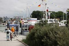 MS Seelöwe (dididumm) Tags: summer vacation port germany boot harbor boat ship cyclist sommer urlaub balticsea biker sealion hafen ostsee schiff schleswigholstein radfahrer seelöwe lübeckerbucht niendorf bayoflübeck