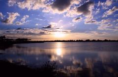 Monday Blues (PelicanPete) Tags: park county blue sunset lake reflection clouds unitedstates florida south blues everglades rays bocaraton monday cloudscape regional browardcounty calmwater sunstream slightbreeze