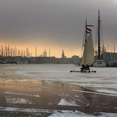 Ice sailing in Monnickendam to keep history alive (Bn) Tags: winter sunset sun sunlight haven cold holland ice netherlands dutch boats harbor topf50 day sailing cloudy flag iceskating skating thenetherlands wintertime topf100 marken speedskaters waterland monnickendam frozensea markermeer historicalmoment naturalice 100faves 50faves coldwave gouwzee seaofice schaatsfeest schaatstocht ijszeilen dutchskaters gouwsea iceskatingtomarken historischeijstocht 12cmdik groteijsoppervlakte schaatsweekend ijszeiler iceyachting skateoutdoors dutchskatejourney iceinthenetherlands hollandlovesice dichtbevroren 12cmdikijs infiniteseaofice 12cmthickice monnickendammarkenvolendam iceskatingonthegouwsea pwwinter