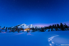 footprints across a lake ([nosamk] KMason photography) Tags: longexposure trees sky mountain snow night stars washington nationalpark unitedstates tracks explore snowshoeing mountbaker deming picturelake interestingness29 sigma15mmf28exdgdiagonalfisheye
