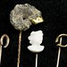 1034. Four Antique Gold and Stone Set Stickpins