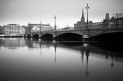 Stockholm Vintage.. (Peter Levi) Tags: longexposure bridge blackandwhite bw snow reflection blancoynegro water architecture 35mm sweden stockholm le x100 blackwhitephotos nd110 fujix100