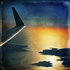 resplendent in the western sun (1crzqbn) Tags: color sunlight reflections shadows resplendentinthewesternsun 1crzqbn aerialshot textures square goldengatebridge airplanewing sunset sliderssunday hss nature blue yellow anawesomeshot artdigital awardtree vividim