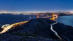 Slacker Hill (chris.chabot) Tags: ocean sanfrancisco california longexposure bridge orange water night river lights bay gate gates arches goldengatebridge citylights roads sparkling lighttrail internationalorange slackerhill