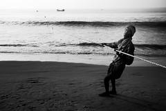 Hard Work (Satyaki Basu) Tags: ocean travel sea india beach fishermen places orissa puri bayofbengal gettyimagesmiddleeast