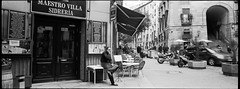 Enjoy the smoke (Jesper Yu) Tags: madrid street old city urban blackandwhite vintage restaurant spain delta hasselblad ilford xpa
