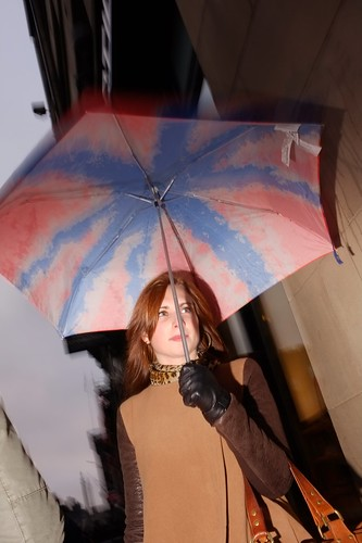 colourful umbrella and spotted neck scarf