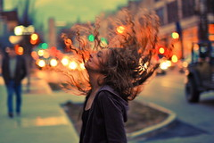 Movement ( NoelleBuske ) Tags: street motion cars girl hair happy lights nikon focus downtown dof asheville bokeh sidewalk hairflip nikond40 noellebuskephotography