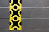 Holes (ByronF) Tags: august2016 austin byronf saturday southcongress texas yellow black wall cinderblock blocks paint hole