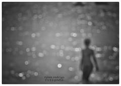 She's dancing amongst the magic dust (Mister Blur) Tags: themission blur blackandwhite playadelcarmen rivieramaya bokeh dots sea dancer nikon d7100