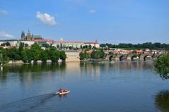Prague : Pedal boat on the Vltava river (Pantchoa) Tags: prague rpubliquetchque vltava moldau riiver charlesbridge churchohsaintfrancis extrieur eau fleuve vhicule pdalo d90 1685 praga praha paysage panorama pontcharles cathdrale pedalboat