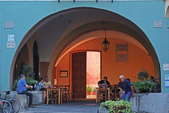a stop under the arch (ludi_ste) Tags: arco arch portico bar caf arcade blu blue village paese dolcedo