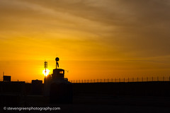 Sunrise at the FOB (Steven Green Photography) Tags: army fob hairatan sunrise afghanistan barbedwire barrier concertinawire deployment forwardoperatingbase military orange perimeter razorwise silhouette sky tower war windsock
