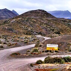 ..Queseria La Pastora Venta de queso artesano Elaborado con leche de cabra y oveja (SS) Tags: road camera travel light summer vacation sky colors weather june composition square landscape island countryside view cross angle pov walk fuerteventura perspective scenic vista framing 2008 depth photosmart vastness atmophere m627