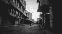 Empty Market (Zagros.os) Tags: white black streets buildings market empty iraq babylon babil hilla karbalaa