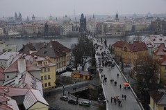 Karlv Most - the iconic Charles Bridge (Saumil U. Shah) Tags: city bridge houses winter wallpaper people snow cold river town rooftops prague charles praha roofs most charlesbridge mala hradcany desktopwallpaper shah strana karlvmost malastrana vlatva karlv star msto starmsto saumil saumilshah