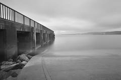 Buncrana pier 3 (Lucan Newland) Tags: ireland sea irish sun fish seaweed water monochrome stone set landscape star pier long exposure lough stones horizon scenic londonderry infrared derry donegal buncrana r72 swilly horison