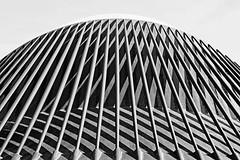 L'Agora (Up Close) (Fuji XE-1) (BW) 18-55mm F2.8-4 (markdbaynham) Tags: street city urban bw white abstract black building valencia lines spain fuji x structure espana 1855mm trans ciutat lagora xe1 f284