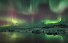 Particle Shower (orvaratli) Tags: pink winter red cold color green ice yellow night landscape iceland arctic aurora northernlights borealis jökulsárlón galcier