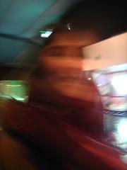 B blur (Ladybadtiming) Tags: winter red portrait girl fun blurry warm colours