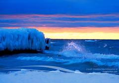 Sunset Splash at Point Betsie (Craig - S) Tags: winter lighthouse lake cold ice water wall mi point waves break michigan freezing stormy seawall lakemichigan mich icy splash pt heavy seas betsie breakwater frankfort splashing whitecaps roiling battering lbreakwall