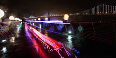 Grand Light Show at the Bay Bridge (Andrew Louie Photography) Tags: show life camera city bridge light party people urban storm cold wet rain night canon project computer disco photography bay san francisco long exposure neon glow leo joy photographers jazz tourist celebration rave trance engineers villareal