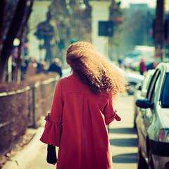 Curls (Brînzei) Tags: street girls red people motion hair lomo bokeh candid victoria squareformat m42 vignette manualfocus ★ explored nofaces bucurești canoneos400d komz jupiter37a135mmf35