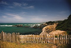 Wooden fence and shallows (wbaiv) Tags: ranch sea sky green texture clouds fence golden w