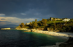 Kassiopi beach 2.........ON EXPLORE! (Sunsword & Moonsabre) Tags: light sunset sea sky sunlight house seascape green abandoned water clouds island photography bay coast spring twilight sand nikon rocks colours view hiking shades greece nikkor corfu kerkyra 2012 balkan kassiopi 1424 d700 nikonfx