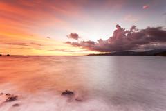 Chasing The Light (Candidasa, Bali) (kontroniks) Tags: longexposure light sunset sea bali orange sun misty bulb clouds nikon rocks peace dusk wideangle dreamy 16mm mode manfrotto candidasa gnd leefilters d700 nikon1635mm