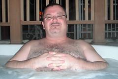 Bear in a tub.. (canadianlookin) Tags: vacation march getaway relaxing hottub northdakota grandforks 2013