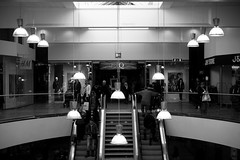 Twelve lamps (DavidAndersson) Tags: people blackandwhite monochrome mall shopping sweden escalator mq lamps 12 hm twelve trollhttan tamron18200f3563 verby jwstore