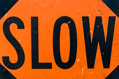 slow-003.jpg (Yvonne Rathbone) Tags: flickrlounge sundaytheme letters letterssigns orange sign slow technical 1855mmf3556gvr