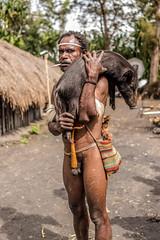 Man with Piglet (tehhanlin) Tags: indonesia papua westpapua irianjaya wamena jayapura nusantara sony a7r2 a7rm2 humaninterest tribe thedanis sukudani portrait pigfeast earthoven ngc