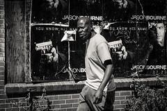 betrayal (jeff_tidwell) Tags: street streetphotography streetphoto blackandwhite candid movie poster gun bourne city urban denver