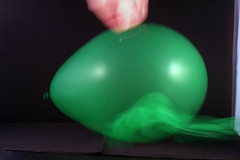 Day 345 - Popping a balloon (Ben936) Tags: green pin dynamic ballon pop burst wispy highspeed popping deflate twoinone