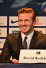 David Beckham attends a press conference after signing up for the football club Paris Saint-Germain