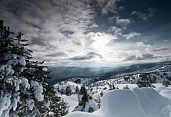 Winter (ChrisBrn) Tags: trees snow mountains clouds greece rays