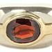 1021. Two Color Gold and Garnet Ring