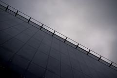 Wall of glass (DavidAndersson) Tags: windows sky building monochrome wall gteborg gothenburg lookingup diagonal tamron18200f3563