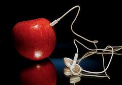 Organic iPod (Light Collector) Tags: red apple ipod organic earphones visualpun ourdailychallenge beginswitha