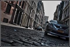 Sunny in Soho (Dov Plawsky) Tags: street new york city newyorkcity trip vacation sun holiday texture car photography nikon shadows map manhattan soho sunny grand cobblestone nikkor greene tone dov plawsky