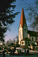 St Bernhard Church With Cemetary (Isengardt) Tags: old blue trees shadow sky friedhof church canon religious eos stuttgart alt framed cemetary prayer religion pray kirche bluesky 1855 blau bume schatten blauerhimmel esslingen evangelical beten badenwrttemberg evangelisch religis gerahmt 550d evangelic regionstuttgart