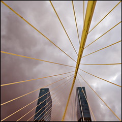 Centipede (Maerten Prins) Tags: bridge sky building lines clouds spain skyscrapers footbridge squares bilbao calatrava blocks centipede sortof zubizuri whitebridge explored puentedelcampovolantin campovolantinbridge