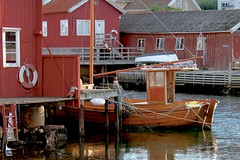 At the harbor (K Nilsen) Tags: old buildings harbor boat wooden sweden coastal sverige lifebuoy bohusln anchored boathouses grundsund vstkusten motorsailer skaft