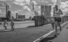 contradiction rotterdam (Peter M. Meijer) Tags: rotterdam netherlands holland street strada strasse straat urban city people man woman fujix70 185mm candid closeup 2016 august femalerunner elderlycouple