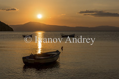 Sunset in a quiet bay (Ivanov Andrey) Tags: sea ocean boat sunset evening sun coast sky beach water reflection air bay beauty blue cape cliff cloud explore harbor horizon island journey landscape nature wave tide surface peloponnese greece