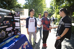 Rush Week in the Library Quad is in full effect as club members of History Makers  Daniel Yun, left, and Gabriel Torres, center  introduce themselves to Jesse Vue. (Sac State) Tags: public affairs california state university sacramento vernone sacstate sacramentostate calif usa us