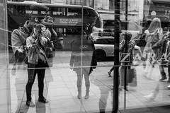 Us (Gary Kinsman) Tags: fujix100t fujifilmx100t london w1 westend oxfordstreet 2016 bw blackwhite reflection shop layers multiple pulp zara window glass