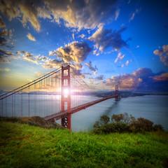Golden Gate Sunrise (Michael Lawenko dela Paz) Tags: sanfrancisco california usa northerncalifornia clouds sunrise colorful goldengatebridge flare sausalito beautifulclouds sunflare stunningcolors amazingsunrise top20bridges stunningclouds beautifulbridge colorfulcountry bestcapturesaoi flickrsfinestimages1 flickrsfinestimages2 flickrsfinestimages3 besteverdigitalphotography